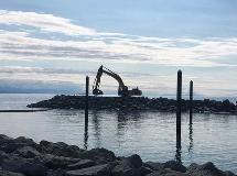 The silhouette of an excavator working on the southern breakwater